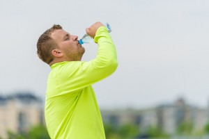 Man drinking water after workout